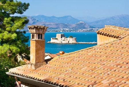 bourtzi: The old venetian castle, named Bourtzi (Tower) locates in Argolic Gulf near port of Nafplio, Greece. Editorial
