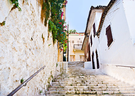nafplio: The steep stairs on the hill with the old houses, surrounding the staircase, Nafplio, Greece.
