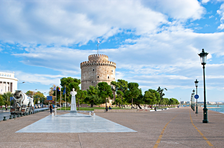 THESSALONIKI, GREECE - OCTOBER 17, 2013: The White Tower and Admiral Votsis Statue locates on the sea promenade, on October 17 in Thessaloniki. Editorial