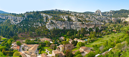 fontaine: The picturesque view on Alpilles and Fontaine Valley from the rocky spur of Les Baux-de-Provence village, France.
