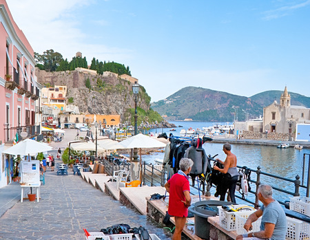 lipari: LIPARI, ITALY - SEPTEMBER 30, 2012: The sea promenade in Marina Corta Port with where tourists can rent the scuba diving equipment, souvenirs, visit cafes and bars, on September 30 in Lipari.