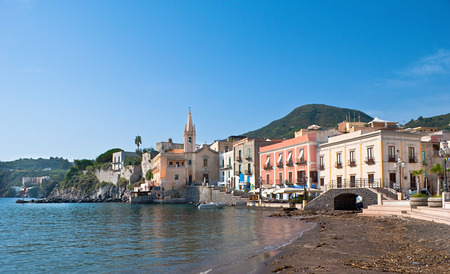 The old port of Marina Corta with a beach of black volcanic sand is rich for souvenir shops, bars, tiny cafes, small church of the Souls of Purgatory, Lipari Island, Italy.