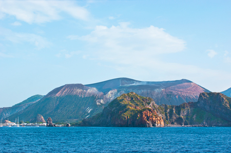 vulcano: The smoking Fossa cone with the old  traces of eruption on its slope, Vulcano Island, Italy. Stock Photo