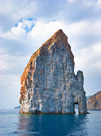 The best way to get enjoy on Aeolian islands is to take a boat and admire the coastline and unusual shaped rocks, Italy.