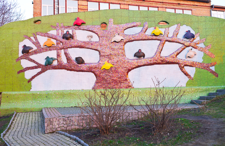 KIEV, UKRAINE - MARCH 9, 2014: The playground on Landscape Alley made by Konstantin Skretutskiy with the sculpture of the tree with different birds, on March 9 in Kiev.