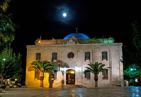 moresque: The Ottoman Vezir Mosque, that nowadays became the basilica of St Titus is very beautiful in the evening lights, Heraklion, Crete, Greece. Stock Photo