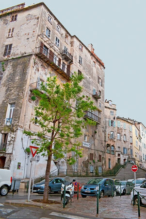 craquelure: BASTIA, FRANCE - MAY 1, 2013: The historical city centre is full of the slums with crumbling plaster and peeling paint, on May 1 in Bastia.