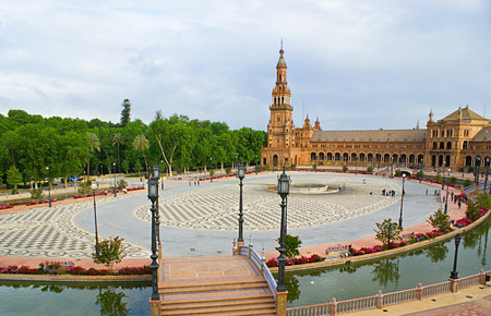 SEVILLE, SPAIN - MAY 3, 2012: The Spain Square is famous for the great architecture and perfectly landscaped Maria Luisa Park located close to it, on May 3 in Seville.