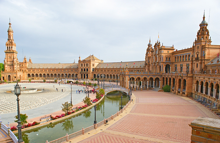 SEVILLE, SPAIN - MAY 3, 2012: The central building with the south wing of the great exhibition city complex on the Spain Square, on May 3 in Seville.