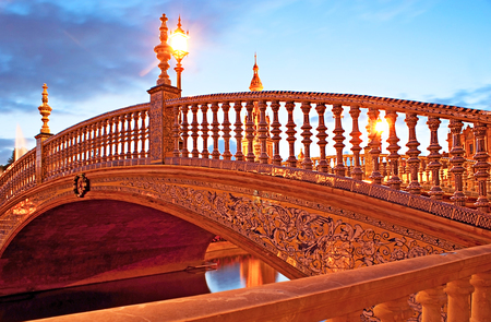 hand rails: The tiny bridge decorated with painted tiles, ceramic hand rails and scenic streetlights, Spain Square, Seville, Spain.