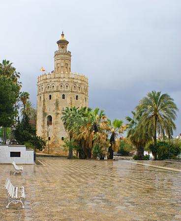 The Torre del Oro (Golden Tower) is a military watchtower, built  to control access to Seville via the Guadalquivir river, Paseo de Cristobal Colon, Spain. photo