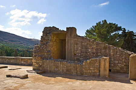 The ruins of Knossos Palace with the green hill on the background, Crete, Greece. photo