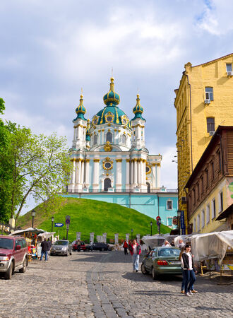 bartolomeo rastrelli: KIEV, UKRAINE - MAY 1, 2014: The St Andrews Church overlooks the historic Podil neighborhood, situated on a steep hill, on the top of Andrews Descent, on May 1 in Kiev.