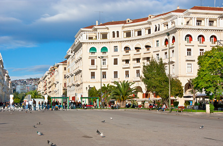 THESSALONIKI, GREECE - OCTOBER 17, 2013: Aristotle Square located next to the Nikis avenue (on the citys waterfront) and is popular tourist place because of numerous stores, cafes and boutiques there, on October 17 in Thessaloniki.