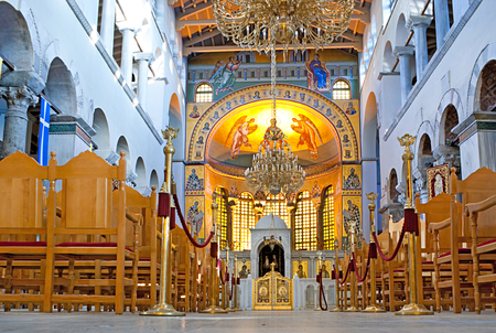 THESSALONIKI, GREECE - OCTOBER 17, 2013: The interior of Saint Demetrius Church with painted cupola and gorgeous chandeliers, on October 17 in Thessaloniki.