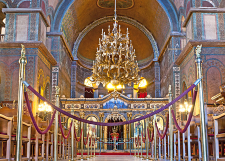 iconostasis: THESSALONIKI, GREECE - OCTOBER 17, 2013: The interior of Hagia Sophia church with impressive iconostasis, plain gold mosaics in the apse, huge golden chandelier and beautiful traceries on the walls, on October 17 in Thessaloniki. Editorial