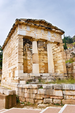 The reconstructed Athenian Treasury, built to commemorate their victory at the Battle of Marathon, Delphi, Greece. photo