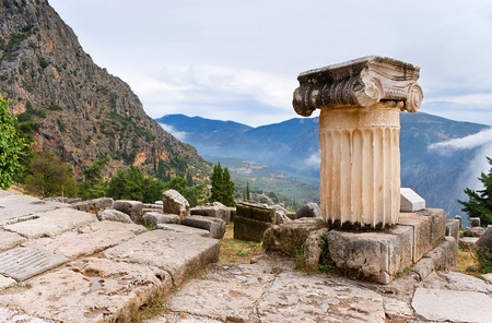 The ruins of ancient Delphi with a view on the foggy valley and Parnassus mountains, Greece. photo