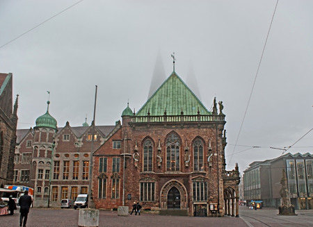 BREMEN, GERMANY - NOVEMBER 21, 2012: The spires of St Peters Cathedral are hardly visible in fog, behind the Town Hall, on November 21 in Bremen. Editorial