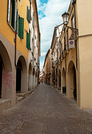 residential neighborhood: PADUA, ITALY - APRIL 23, 2012: The medieval residential neighborhood of the city consists of such narrow winding streets with scenic arcades on the ground floors of villas, on April 23 in Padua.