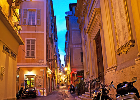 backstreet: NICE, FRANCE - APRIL 24, 2012: There are many possibilities to spend evening on the resort of french riviera, probably the best choice would to go to one of the old cafes on some narrow medieval street, on April 24 in Nice. Editorial