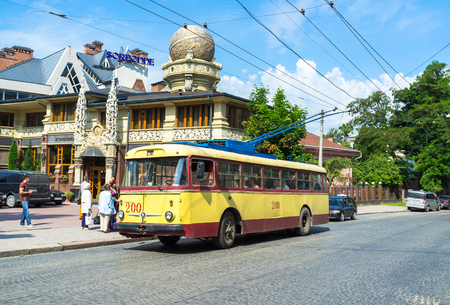 chernivtsi: CHERNIVTSI, UKRAINE - JUNE 20, 2014: The trolley on the station next to the unusual building of the Restaurant Sorbonne in the city centre, on June 20, 2014. Editorial
