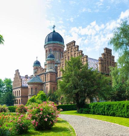 chernivtsi: CHERNIVTSI, UKRAINE - JUNE 20, 2014: The scenic garden surrounds former Seminary Church on the territory of the National University, on June 20, 2014.
