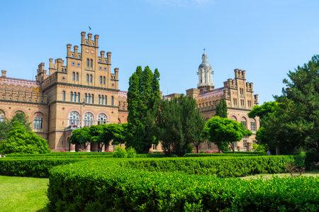 chernivtsi: CHERNIVTSI, UKRAINE - JUNE 20, 2014: The complex of the National Univercity surrounded by the ornamental garden with the scenic rose bushes, on June 20, 2014.
