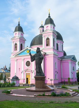 chernivtsi: CHERNIVTSI, UKRAINE - JUNE 20, 2014: The Cathedral of the Holy Spirit with the monument to the first Metropolitan of Bukovyna and Dalmatia Eugene (Hakman), on June 20, 2014.