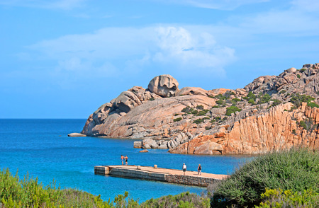 LA MADDALENA, SARDINIA - SEPTEMBER 25, 2012: The beach of Cala Spalmatore, sheltered from the winds by two headlands of splendid pink coloured rocks, on September 25 in La Maddalena.