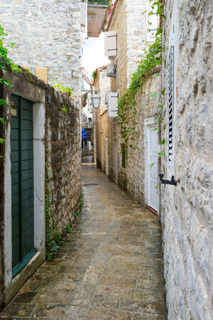 The old town-citadel of Budva consists of many narrow streets and lanes, full of souvenir shops, cafes, bars and medieval landmarks, Montenegro. photo