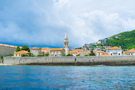 best way: The best way to explore the old Venetian citadel of Budva is to take a boat trip along the coastline, Montenegro. Stock Photo