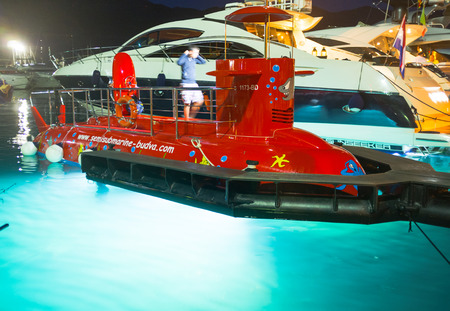 powerfull: BUDVA, MONTENEGRO - JULY 12, 2014: The glass-bottom submarine demonstrates its powerfull lights for the night discovery of the seabed, on July 12 in Budva.