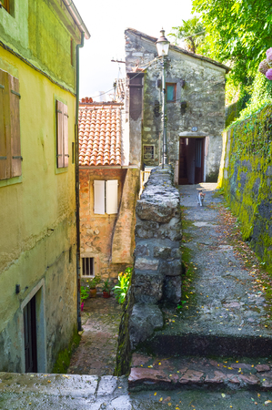 The narrow courtyard located on the hilly area in the old town of Kotor, Montenegro. photo