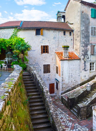 The long staircase leads to the top of the old rampart and another one goes to the hill, Kotor, Montenegro. photo