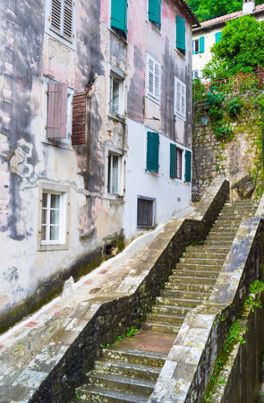 The old Kotor located at the feet of the mountain, so there are many streets with the stairs, going up to the medieval fortress top, Montenegro. photo
