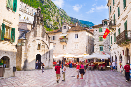 KOTOR, MONTENEGRO - JULY 15, 2014: The tourists like to spend their time on the cozy squares and streets of the medieval town, there are many cafes, shops and bars for relaxation, on July 15 in Kotor.
