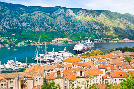 The best way to discover the Kotor bay is to visit the Fortress of St John, here tourists can find many viewpoints with the excellent views on the old town, harbor, shipyard and mountains, Kotor, Montenegro. photo