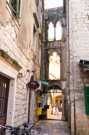 KOTOR, MONTENEGRO - JULY 15, 2014: The wall with the gothic windows is the only preserved part of the medieval house, on July 15 in Kotor.