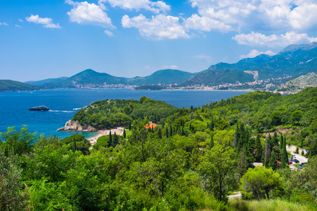 The Budva riviera boasts the scenic rocky coastline, comfortable sand beaches and large areas of shady gardens, Sveti Stefan, Montenegro.
