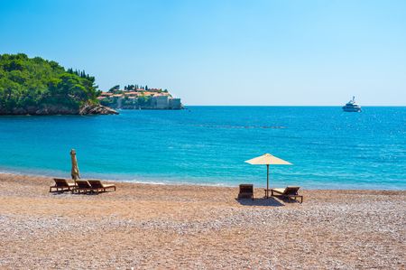 The view on the Sveti Stefan islet from the Queens beach of the Villa Milocer, Montenegro.