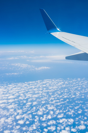 boing: The plane flies over the Mediterranean sea with the scenic cloudscape.