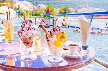 na: The cafes on embankment of the old Petrovac are famous for its tasty desserts and invigorating espresso, Montenegro.
