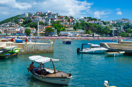 ULCINJ, MONTENEGRO - JULY 14, 2014: The cityscape with the Sailor Mosque, central beach and the shipyard, on July 14 in Ulcinj.