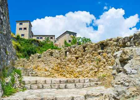 The narrow staircase leads to the Kalaja fortress with many cafes and restaurants for the tourists pleasure, Ulcinj, Montenegro. photo