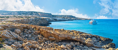 The trip along the Famagusta bay is very popular among tourists, they enjoy the views from Ayia Napa to Protaras and swim next to Cape Greco, Cyprus. Editorial