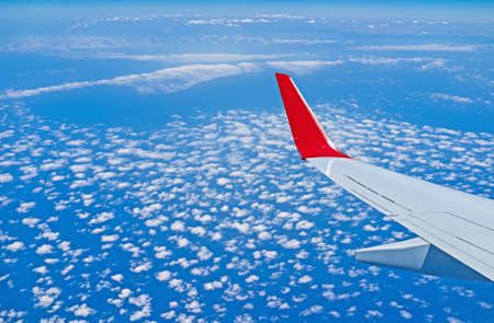 boing: The plane flies over the Mediterranean sea and the turkish coastline with the scenic cloudscape.