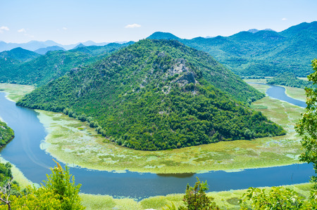 flaws: The Crnojevica river flaws among the mountains to the Skadar lake, Montenegro. Stock Photo