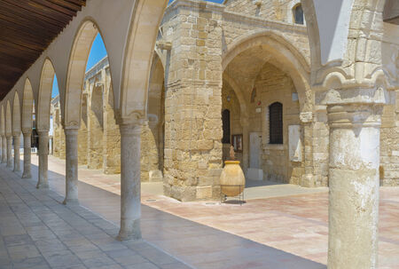 lazarus: The shady terrace of the Ecclesiastical museum surrounds the St Lazarus church, Larnaka, Cyprus.