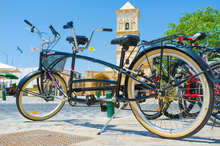 lazarus: The tandem bicycle stands on the parking next to the St Lazarus church, Larnaka, Cyprus.